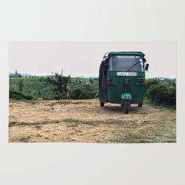 Tuktuk on a mountain top Rug
