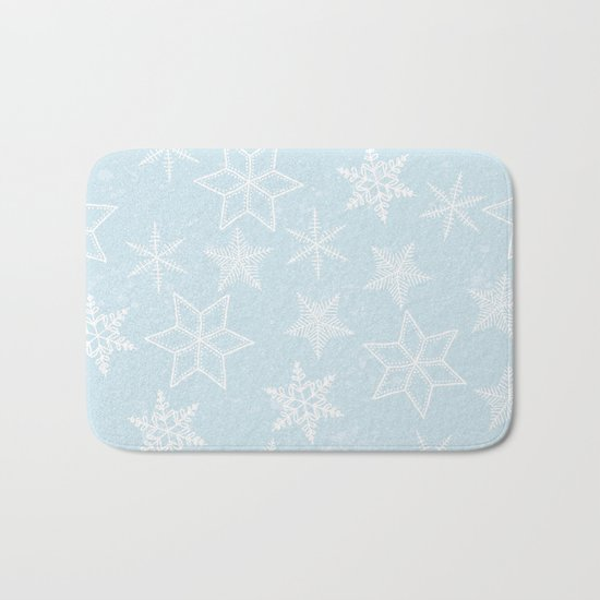 Snowflakes on light blue background Bath Mat