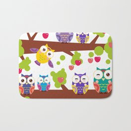bright colorful owls on the branch of a tree with red apples Bath Mat