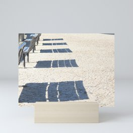 Shadows of empty benches Mini Art Print