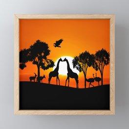 Giraffe silhouettes at sunset Framed Mini Art Print
