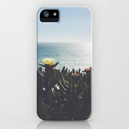 cactus flowers in front of the ocean iPhone Case