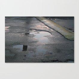 sun over rain puddles Canvas Print