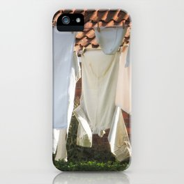 Hanging laundry in the wind iPhone Case