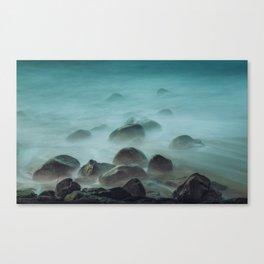 Ocean waves against the rocks Canvas Print