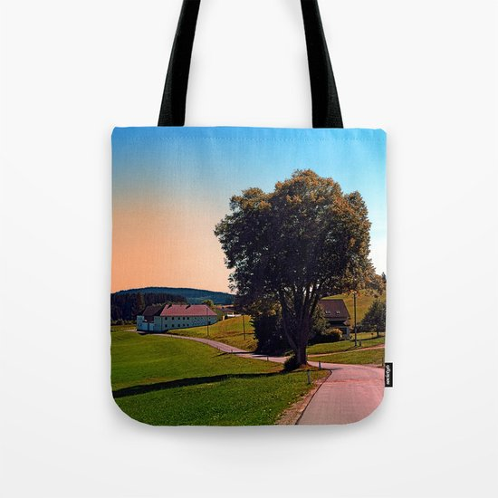 A tree, a road and summertime Tote Bag