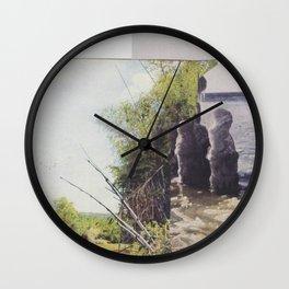denials a bitch Wall Clock