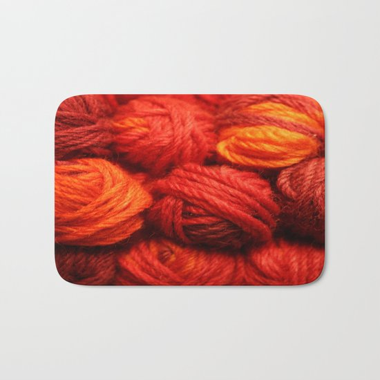 Many Balls of Wool in Shades of Red Bath Mat