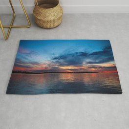 Sunset at sea. Sky full of clouds of beautiful colors. Rug