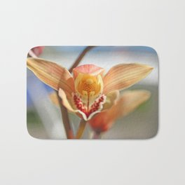 orchid flower ready to fly Bath Mat