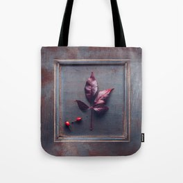 Wooden frame with an dried leaf Tote Bag