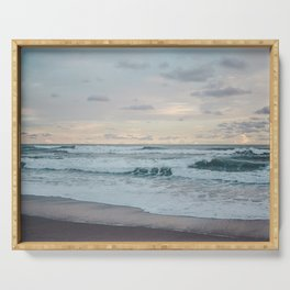 Soft turquoise waves wash up on a paradise beach in Costa Rica at a candyfloss pink sunset Serving Tray