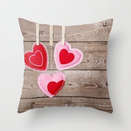I - Clothesline with Valentine's Day hearts decorations on a rustic background Throw Pillow