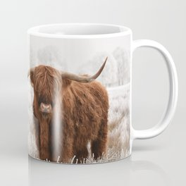 Hairy Scottish highlanders in a natural winter landscape. Coffee Mug