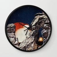 queens of the stone age Wall Clocks featuring Stone Age by Collage Calamity