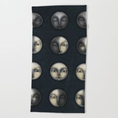 moon phases and textured darkness Beach Towel