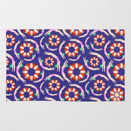 Summer Swimmers in Pink on Navy | Floats | Life Savers | pulps of wood Rug