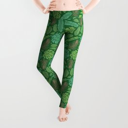Tropical leaves mix on green background Leggings
