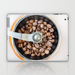 Roasted coffee beans in a manual coffee grinder. The view from the top. Laptop & iPad Skin