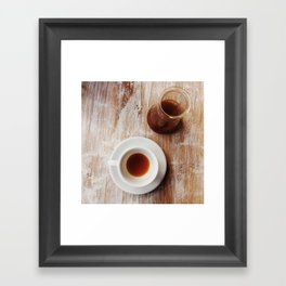 Coffee on the table Framed Art Print