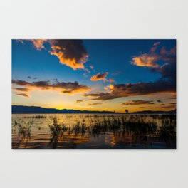 Sunset clouds over lake Canvas Print