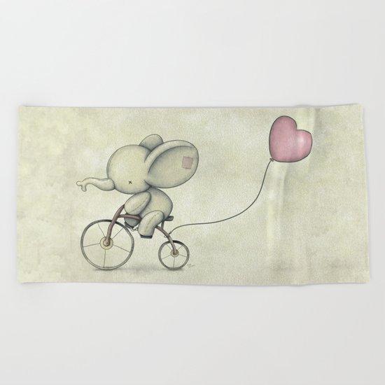 Cute Elephant riding his bike Beach Towel