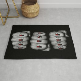 FREE FIST BUMP / Photograph of grungy fists with tattooed knuckles Rug