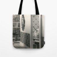 tim burton Tote Bags featuring Hanging a painting fail - tim burton by PaperTigress