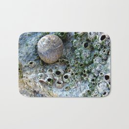 Nacre rock with sea snail Bath Mat