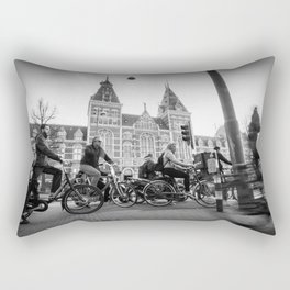 Cyclists ride in Amsterdam street in front of the Rijksmuseum Rectangular Pillow