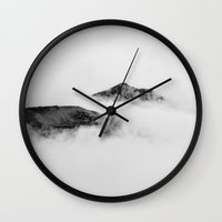 Wall Clocks featuring Mountains in the Clouds by Kurt Rahn