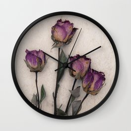 four dried roses Wall Clock