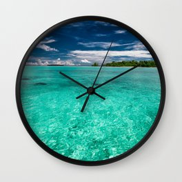 The turquoise shallows of paradise Wall Clock