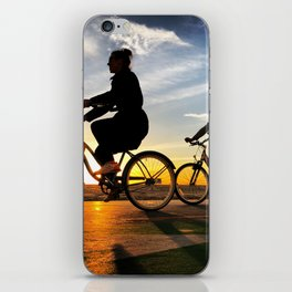 Cycling on sunset in Santa Monica, California, USA iPhone Skin