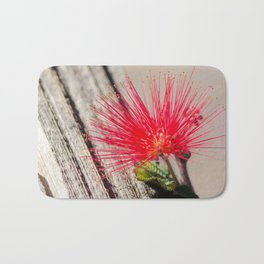 Red Bottle Brush Flower against Barn Wood Bath Mat