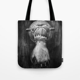 The hand on the door Tote Bag