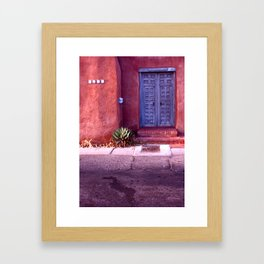 blue door red wall Framed Art Print