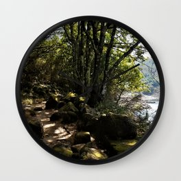 Path under the trees along the bank of a reservoir Wall Clock