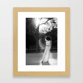 Woman in sunlight Framed Art Print