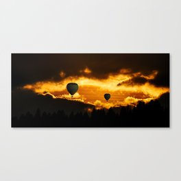 Exotic and magnificent afternoon at Sunset time and hot air balloon on dark and gold fuzzy sky Canvas Print