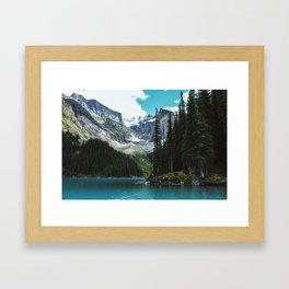 Canoeing in Moraine lake Framed Art Print