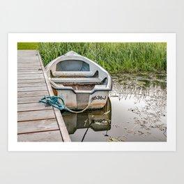 Moored row boat Art Print