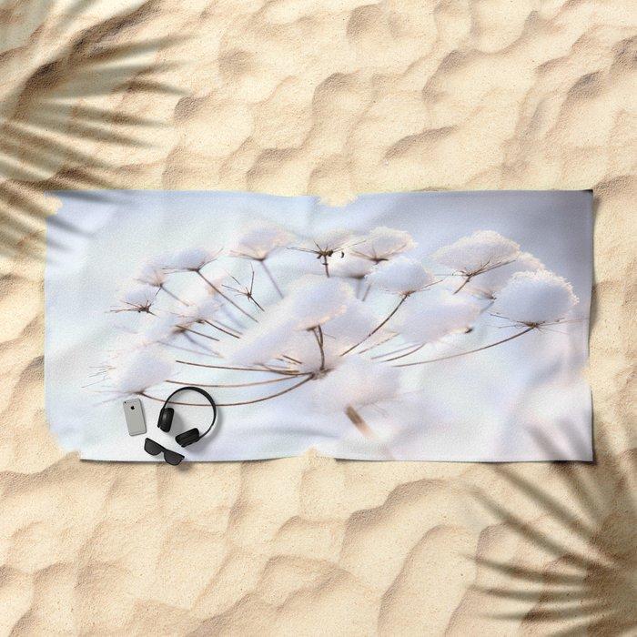 Snow covered dryflower Beach Towel