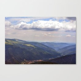 Natural scenery with mountains view and cloudy sky. Canvas Print