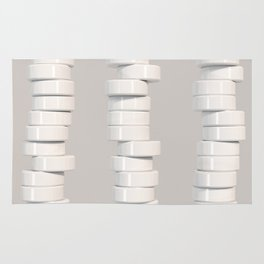 Pattern of white cylinders Rug