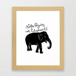 Ride bicycles not elephants. Black text Framed Art Print