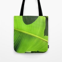 banana leaf Tote Bags featuring Banana Leaf, Dark Shadows by Glenn Designs