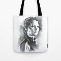 katniss Tote Bags featuring Katniss by Nienke Feirabend