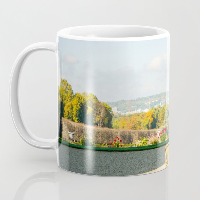 A couple of chairs on the top of a lookout watching the landscape I Coffee Mug