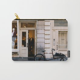 Old bicycle parked at luxury fashion store in New York Carry-All Pouch